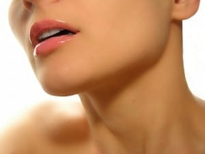 A close up of a gir's youthful neck, chin, and lips