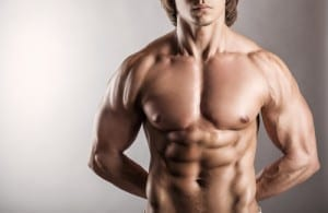 Shirtless male with pectoral implants
